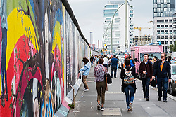 murals painted on original section of Berlin Wall at East Side gallery in Berlin, Germany ...Editorial Use Only