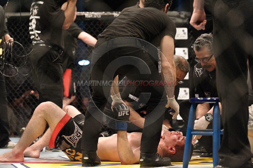 "ABU DHABI, UNITED ARAB EMIRATES, APRIL 10, 2010: Matt Veach lays on the canvas as medical officials examine him at  ""UFC 112: Invincible"" inside Ferari World, Abu Dhabi on April 10, 2010"