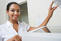 Woman Using Photocopier