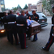 The casket carrying U.S. Marine Sgt. William Stacey is loaded into a hearse after his funeral on Saturday, February 11, 2012 at the University of Washington in Seattle. Stacey was killed on January 31st in Helmand Province, Afghanistan. (Photo by Joshua Trujillo, seattlepi.com)