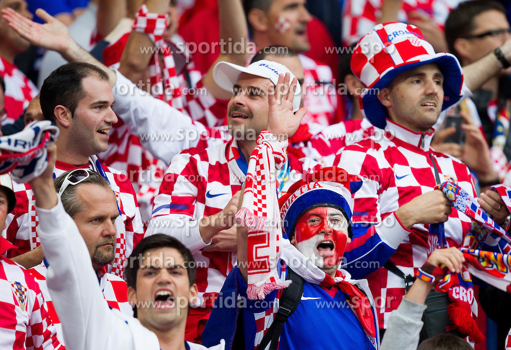Fans of Croatia celebrate during the UEFA EURO 2012 group C match between Italy and Croatia at Poznan City Stadium on June 14, 2012 in Poznan, Poland.  (Photo by Vid Ponikvar / Sportida.com)