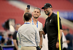 MADRID, SPAIN - Friday, May 31, 2019: A journalist takes a selfie with Liverpool's manager Jürgen Klopp during a training session ahead of the UEFA Champions League Final match between Tottenham Hotspur FC and Liverpool FC at the Estadio Metropolitano. (Pic by Handout/UEFA)