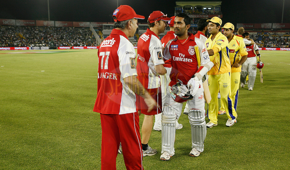 Players of opposite teams meet each other after match 9 of the Indian Premier League ( IPL ) Season 4 between the Kings XI Punjab and the Chennai Super Kings held at the PCA stadium in Mohali, Chandigarh, India on the 13th April 2011..Photo by Money Sharma/BCCI/SPORTZPICS