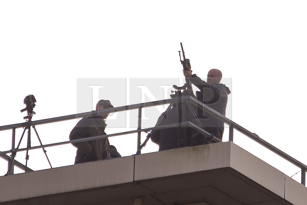 © Licensed to London News Pictures. 30/09/2019. Manchester, UK. Armed police police on the roof of a nearby building on the second day of the Conservative Party Conference at Manchester Central in Manchester. Photo credit: Andrew McCaren/LNP