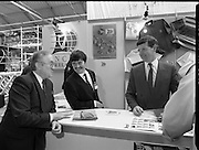 The 1989 Boat Show.   (R89)..1989..10.03.1989..03.10.1989..10th March 1989..Pat the Cope GallagherTD, Minister for the Marine attended the opening of the 1989 Boat Show held at the Point Depot, Dublin. The opening coincided with the minister's birthday...The Minister for the Marine, Pat The Cope Gallagher ,is pictured, sampling the wares at the NCB Ireland stand at the Boat Show.  NCB firmly established its reputation by sponsoring a yacht NCB Ireland in the 1989 Whitbread Round-the-world yacht race