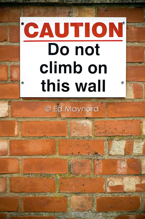 Caution Do Not Climb On This Wall sign, Leicestershire, England, UK.