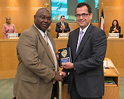 Byron Thurmond, left, receives the Employee of the Month award from CFS general manager Joel Falcon, right, September 12, 2013.