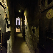 View of the corridor along death row, where prisoners destined for execution were kept in isolation. On either side are doors to the cells. In the distance, down the corridor, is one of the guillotines that the French colonial government used for executions. Hoa Lo Prison, also known sarcastically as the Hanoi Hilton during the Vietnam War, was originally a French colonial prison for political prisoners and then a North Vietnamese prison for prisoners of war. It is especially famous for being the jail used for American pilots shot down during the Vietnam War.