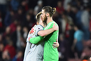 Luke Shaw (23) of Manchester United hugs David De Gea (1) of Manchester United at full time after a 2-0 win over Bournemouth during the Premier League match between Bournemouth and Manchester United at the Vitality Stadium, Bournemouth, England on 18 April 2018. Picture by Graham Hunt.
