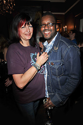 ORLANDO HAMILTON and his wife VICKIE at a party to celebrate the publication of her new book - Kelly Hoppen: Ideas, held at Beach Blanket Babylon, 45 Ledbury Road, London W11 on 4th April 2011.