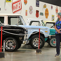 Yvonne Hogan, from Bay of Plenty New Zealand, looks over the classic truck exhibit at the Tupelo Automobile Museum on Tuesday. The exhibit is going on until September 30.