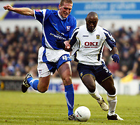 Photo: Chris Ratcliffe.<br />Ipswich Town v Portsmouth. The FA Cup. 07/01/2006.<br />Lomana Lua Lua (R) and Jason De Vos of Ipswich battle it out.