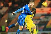 Callum Camps is fouled by Scott Wagstaff during the EFL Sky Bet League 1 match between Rochdale and AFC Wimbledon at Spotland, Rochdale, England on 19 February 2019.