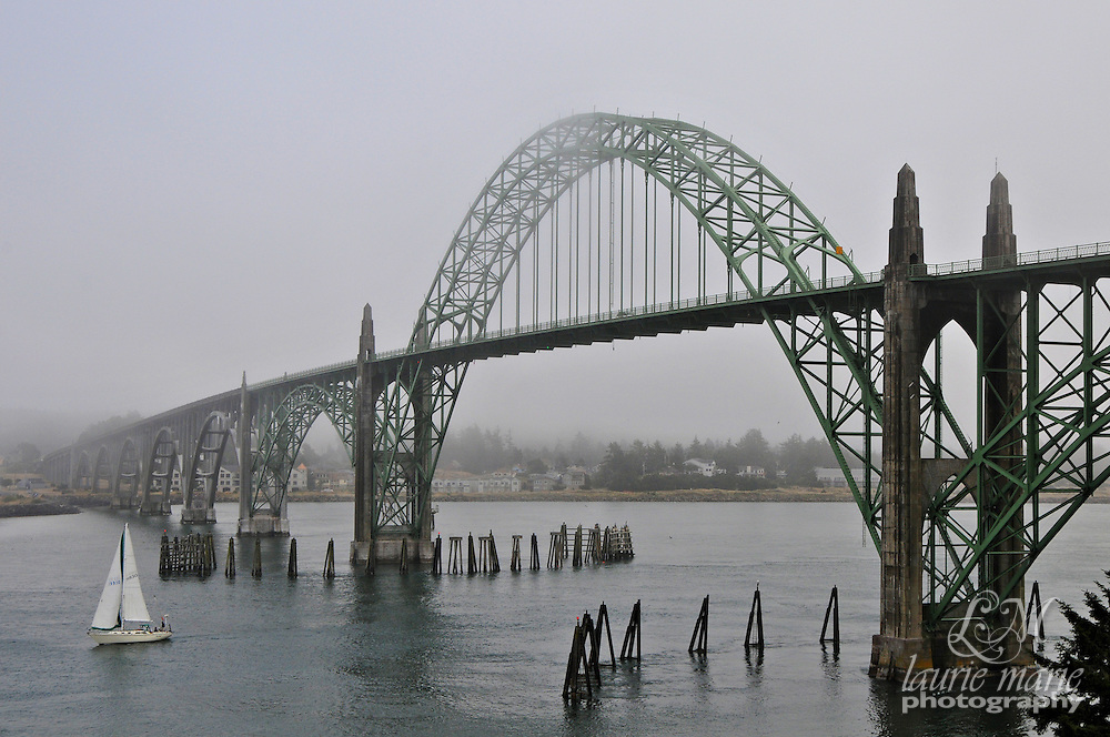 Yaquina Bay Bridge on a foggy day over Yaquina Bay in Newport, Oregon Coast