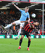 Oleksandr Zinchenko (35) of Manchester City battles for possession with Joshua King (17) of AFC Bournemouth during the Premier League match between Bournemouth and Manchester City at the Vitality Stadium, Bournemouth, England on 2 March 2019.