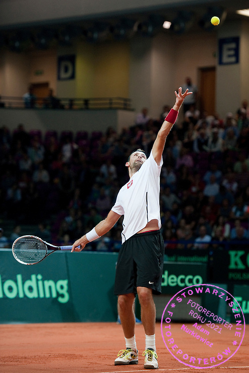 Lukasz Kubot of Poland in action during the BNP Paribas Davis Cup 2013 between Poland and Australia at Torwar Hall in Warsaw on September 15, 2013.<br /> <br /> Poland, Warsaw, September 15, 2013<br /> <br /> Picture also available in RAW (NEF) or TIFF format on special request.<br /> <br /> For editorial use only. Any commercial or promotional use requires permission.<br /> <br /> Photo by © Adam Nurkiewicz / Mediasport
