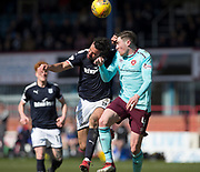 1st April 2018, Dens Park, Dundee, Scotland; Scottish Premier League football, Dundee versus Heart of Midlothian; Sofien Moussa of Dundee and John Souttar of Hearts battle in the air