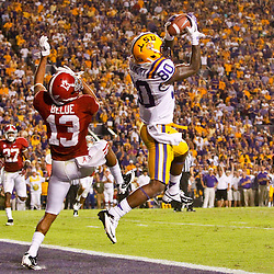 November 3, 2012; Baton Rouge, LA, USA; LSU Tigers wide receiver Jarvis Landry (80) catches a touchdown over Alabama Crimson Tide defensive back Deion Belue (13) during the fourth quarter of a game at Tiger Stadium.  Mandatory Credit: Derick E. Hingle-US PRESSWIRE
