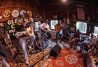 "Drew Seneca, Carl Deprospo, Roger Cummings, Tom Dunfee and Jimmy Makris play a session during ""Duanestock"" held in Duane Johnson's 133 year old barn on Saturday evening with family and friends.  (Karen Bobotas/for the Laconia Daily Sun)"