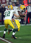 Green Bay Packers quarterback Aaron Rodgers (12) hands off the ball to Green Bay Packers running back Eddie Lacy (27) on a first quarter run during the NFL NFC Divisional round playoff football game against the Arizona Cardinals on Saturday, Jan. 16, 2016 in Glendale, Ariz. The Cardinals won the game in overtime 26-20. (©Paul Anthony Spinelli)