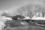 Rural Kentucky bridge over flowing creek in Winter.  Infrared (IR) photograph by fine art photographer Michael Kloth. Black and white infrared photographs
