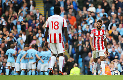Stoke City players look dejected as Manchester City players celebrate after the fourth goal - Mandatory by-line: Matt McNulty/JMP - 14/10/2017 - FOOTBALL - Etihad Stadium - Manchester, England - Manchester City v Stoke City - Premier League