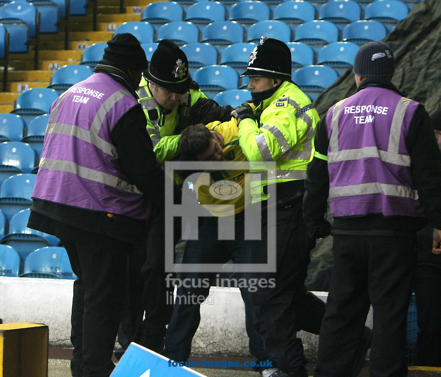 Leeds - Saturday February 19th, 2011: Two Norwich fans are ejected after a clash with Police and Stewards at the end of the Npower Championship match at Elland Road, Leeds. (Pic by Paul Chesterton/Focus Images)