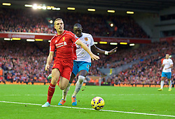 25.10.2014, Anfield, Liverpool, ENG, Premier League, FC Liverpool vs Hull City, 9. Runde, im Bild Liverpool's Jordan Henderson is fouled by Hull City's Mohamed Diame, but instead of penalty the referee showed a yellow card to the Liverpool player, // 15054000 during the English Premier League 9th round match between Liverpool FC and Hull City at the Anfield in Liverpool, Great Britain on 2014/10/25. EXPA Pictures © 2014, PhotoCredit: EXPA/ Propagandaphoto/ David Rawcliffe<br /> <br /> *****ATTENTION - OUT of ENG, GBR*****