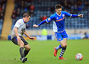 Scott Tanser, Chris Hussey during the The FA Cup match between Rochdale and Bury at Spotland, Rochdale, England on 6 December 2015. Photo by Daniel Youngs.
