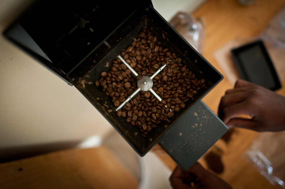 Coffee being ground for the 'Cup of Excellence' Pre-Trials, at a laboratory in Kayonza, Rwanda. Now in it's 4th year in Rwanda, the Cup of Excellence is one of the world's most prestigious specialty coffee competitions. Rwanda was the first country in Africa to hold a Cup of Excellence.