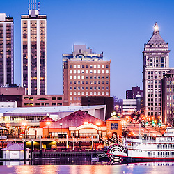 Peoria Illinois skyline at night panoramic picture with downtown city buildings reflection on the Illinois River and the Spirit of Peoria paddlewheel riverboat. Photo panoramic ratio is 1:3.