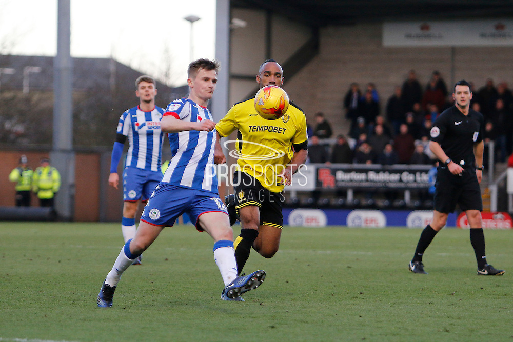 New signing Wigan Athletic defender Callum Connolly (12) and Burton Albion striker Chris O'Grady (8) during the EFL Sky Bet Championship match between Burton Albion and Wigan Athletic at the Pirelli Stadium, Burton upon Trent, England on 14 January 2017. Photo by Richard Holmes.