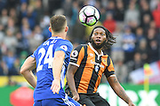 Hull City player Dieumerci Mbokani (18) takes ball from Chelsea defender Gary Cahill (24)  during the Premier League match between Hull City and Chelsea at the KCOM Stadium, Kingston upon Hull, England on 1 October 2016. Photo by Ian Lyall.