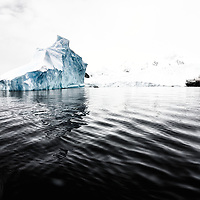 Onboard our expedition vessel Ortelius, we explored the vastness and beauty of the antarctic peninsula during 14 days. This image helps us dimension the size of the icebergs that we encounter on our way.  <br /> <br /> Photographs from the Antarctic Peninsula created by Anuar Patjane during spring 2015