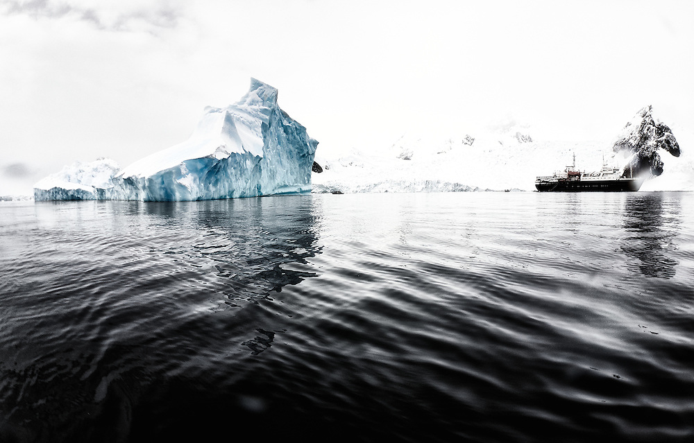 Onboard our expedition vessel Ortelius, we explored the vastness and beauty of the antarctic peninsula during 14 days. This image helps us dimension the size of the icebergs that we encounter on our way.  <br />