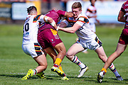 Bradford Bulls winger Edward Chamberlain (40) in the tackle during the Kingstone Press Championship match between Batley Bulldogs and Bradford Bulls at the Fox's Biscuits Stadium, Batley, United Kingdom on 16 July 2017. Photo by Simon Davies.