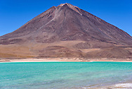 Laguna Verde, at 14, 435 feet above sea level, sits in the southwestern corner of Bolivia, below Volcan Licancabur, which rises to 19,553 feet above sea level, on the border between Bolivia and Chile.