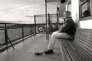 hockey player sitting on Tallequah ferry