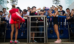 September 22, 2018 - Kristina Mladenovic of France & Elina Svitolina of the Ukraine sign autographs at the 2018 Dongfeng Motor Wuhan Open WTA Premier 5 tennis tournament (Credit Image: © AFP7 via ZUMA Wire)