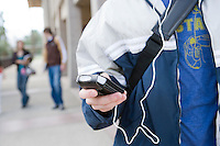 Teenager holding ipod