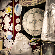 Intricate Belgian lace on display in a shop window of a store in the Lower Town section of Brussels, Belgium. Fine lace is one of the distinctive specialties of the region.