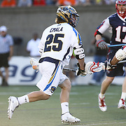 Davey Emala #25 of the Charlotte Hounds controls the ball during the game at Harvard Stadium on May 17, 2014 in Boston, Massachuttes. (Photo by Elan Kawesch)