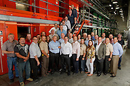 At center, David Landsberg, president and publisher of Miami Herald Media Co. with the move project team with the printing presses in Miami, FL,  on Wednesday, May 22, 2013.