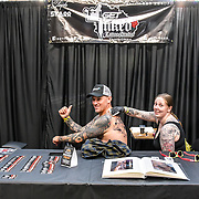Artist Get Inked tattoo a client at The Great British Tattoo Show, London, UK