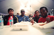 A family in a  New Orleans shelter sharing a meal in the aftermath of Hurricane Katrina