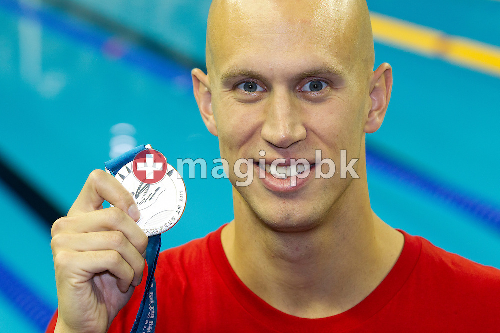Brent HAYDEN of Canada poses with his silver medal won in the men's 100m Freestyle Final at the end of the 14th FINA World Aquatics Championships at the Oriental Sports Center in Shanghai, China, Sunday, July 31, 2011. (Photo by Patrick B. Kraemer / MAGICPBK)