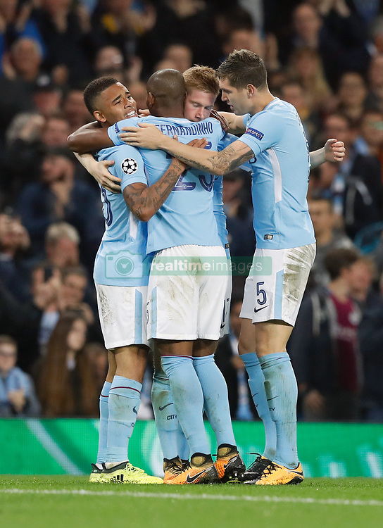 Manchester City's Kevin De Bruyne (centre right) celebrates scoring his side's first goal of the game with team-mates during the UEFA Champions League, Group F match at the Etihad Stadium, Manchester.