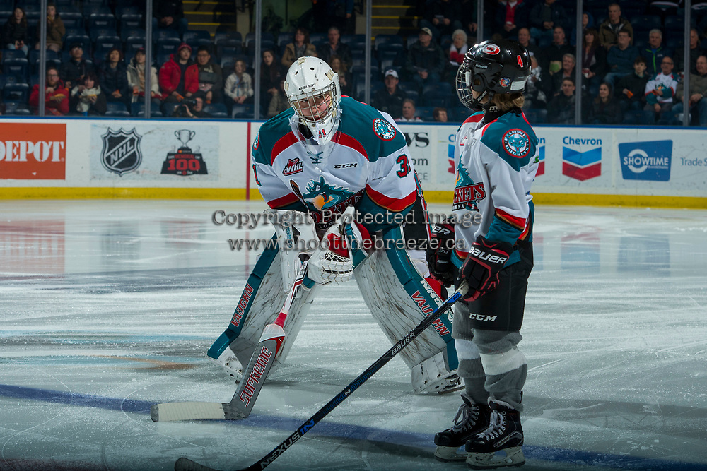 KELOWNA, CANADA - FEBRUARY 23: Graydon Macdonald stands on the blue line as Brodan Salmond #31 of the Kelowna Rockets comes to line up against the Seattle Thunderbirds  on February 23, 2018 at Prospera Place in Kelowna, British Columbia, Canada.  (Photo by Marissa Baecker/Shoot the Breeze)  *** Local Caption ***