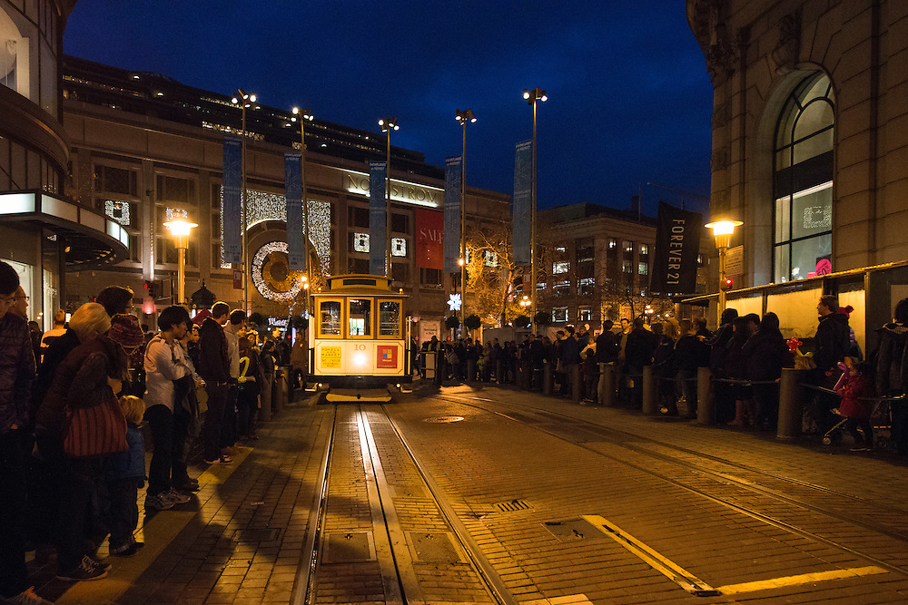 Thousand's waited in line for a free ride on Muni's Cable Cars at the Powell Street turntable on December 28, 2012 when Muni Celebrated it's 100th Birthday. Long lines lasted at all day and into the night as passengers waited to take a ride on San Francisco's fabled Cable Cars, some waiting more than two hours for a ride. | December 28, 2012