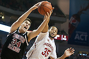 November 30, 2013: Walter Pitchford (35) of the Nebraska Cornhuskers and Marin Maric (34) of the Northern Illinois Huskies going after a rebound at the Pinnacle Bank Areana, Lincoln, NE. Nebraska defeated Northern Illinois 63 to 58.